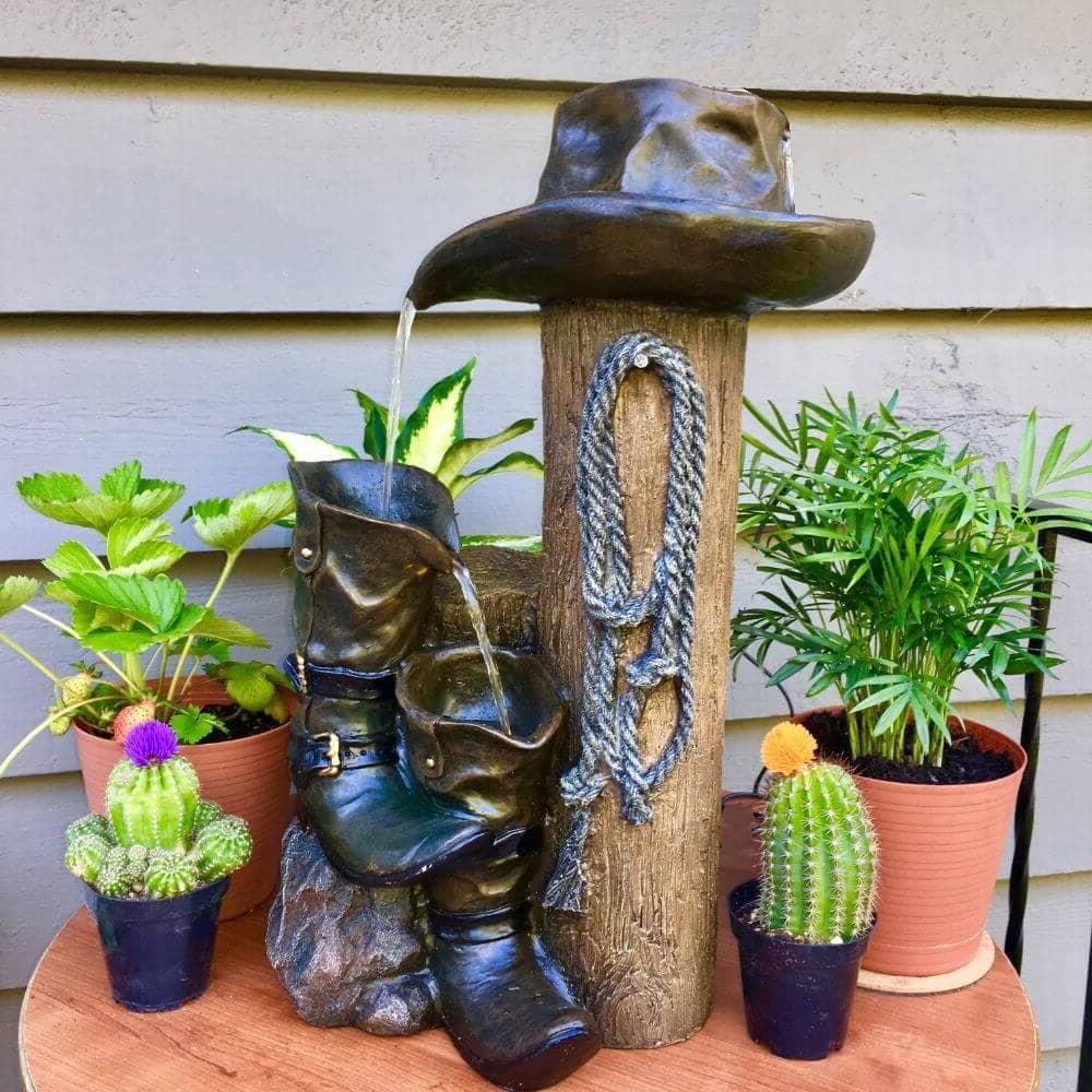 cowboy boots hat wild western water fountains