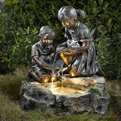 lighted brother sister bronze finish