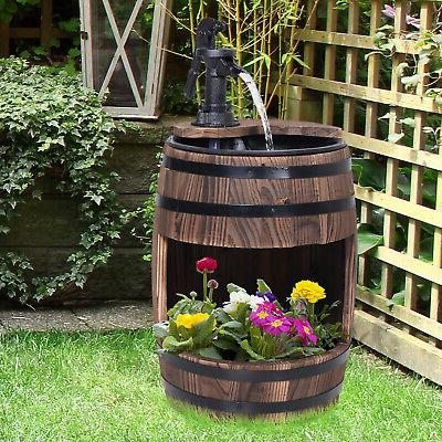 traditional pump barrel water feature with flower
